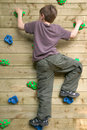 Boy On A Climbing Wall Royalty Free Stock Images - 2335759