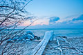 Icy Pier And Boat Slider II Royalty Free Stock Photography - 23335177