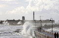 Castle And Lighthouse In Rough Sea, Cadiz Stock Photo - 23348140