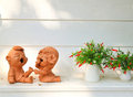 Doll Clay And Flower In Garden Stock Photos - 23373913