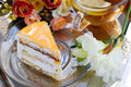Cake With Apricot And Tea Stock Photos - 23386293
