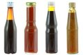 Different Bottles Of Sauce Isolated On White Royalty Free Stock Photography - 23390417