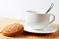Cup Of Coffee And Oatmeal Cookies Stock Image - 23391301