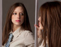 Woman In Tie Looking In Mirror Royalty Free Stock Images - 23406159