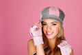 Beautiful Girl In Peaked Cap Royalty Free Stock Photography - 23406847