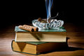 Smoke From Cigar With Ashtray And Two Books Stock Photo - 23406850