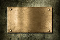 Old Golden Or Bronze Plate On Wall Stock Photography - 23408882