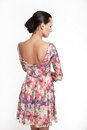 Back Of Young Beautiful Woman In Colorful Dress Stock Photo - 23412220