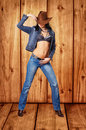 Girl In Jeans With A Cowboy Hat Royalty Free Stock Image - 23428736