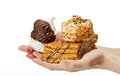 Hands Holding Delicious Sweet Cakes Royalty Free Stock Images - 23431549