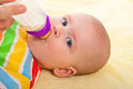 Little Baby With Baby S Bottle Stock Photo - 23439530