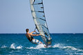 Side View Of Young Windsurfer Stock Photos - 23444393