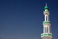White Mosque With Minaret Against Blue Sky Stock Photo - 23467150