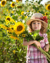 Child With Bunch Of Sunflowers Stock Photography - 23486822