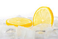 Two Slices Of Fresh Lemon On Ice Cubes Stock Images - 23497134
