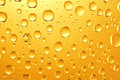 Background Of Golden Water Big And Small Drops Stock Images - 23500714