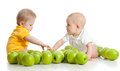 Two Little Children With Green Apples On White Stock Photo - 23510550