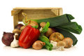 Fresh Assorted Vegetables In A Wooden Crate Royalty Free Stock Images - 23535219