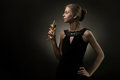 Woman With Wine Glass In Hand Royalty Free Stock Photos - 23541248