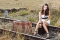 Young Woman Sitting On Railroad Royalty Free Stock Image - 23542936