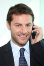 Man Using A Telephone Royalty Free Stock Photography - 23549687