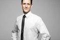 Businessman In White Shirt On Gray Background. Stock Photography - 23564292