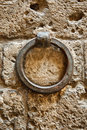 Old Metal Ring On A Stone Wall Royalty Free Stock Photography - 23599317