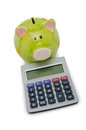 Calculator And Piggy Bank Royalty Free Stock Photo - 23604915