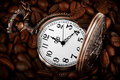 Pocket Watch In Coffee Stock Photo - 23610850