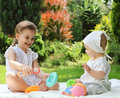 Two Little Sisters In The Summer Garden Royalty Free Stock Photography - 23623847