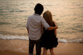 Interracial Lover Couple Huging On The Beach Stock Images - 23624314