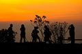 Sunrise With Silhouette Of People Stock Photos - 23624543