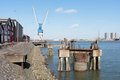 Quayside With Factory Buildings And Crane Royalty Free Stock Photo - 23660485