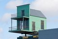 Little House At The Top Of A Bigger Building Royalty Free Stock Photos - 23660498