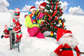 Girls Decking Up The Christmas Tree Stock Images - 23660824