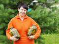Woman-gardener Holds Two Jars With Cucumber Stock Images - 23665614