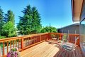 Large New Wood Deck Home Exterior With Chairs. Royalty Free Stock Photography - 23666427