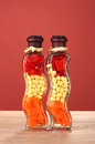 Two Bottles With Red Pepper Royalty Free Stock Photo - 23679785