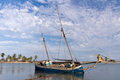 Dhow At Low Tide Royalty Free Stock Images - 23694029