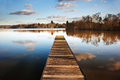 Landscape Of Fishing Jetty On Calm Lake Royalty Free Stock Images - 23704029