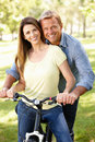 Couple With Bike In Park Royalty Free Stock Image - 23708046