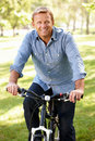 Man Riding Bike In Park Royalty Free Stock Photos - 23708058