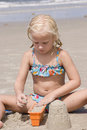 Girl Making Sand Castles At Beach Stock Images - 23731454