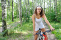 Active Brunette Woman On Red Bicycle Royalty Free Stock Photo - 23752805