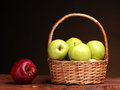 Juicy Green Apples In Basket And Red Apple Royalty Free Stock Photo - 23759145