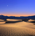 Moon And Dunes Stock Images - 23760284