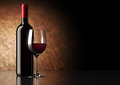 Red Wine Bottle With Glass Royalty Free Stock Photo - 23778615
