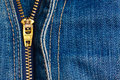 Close Up Of A Zipper Over Blue Denim Royalty Free Stock Image - 23788136