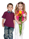 Smiling Boy And Pretty Girl With Flowers Royalty Free Stock Photo - 23826415