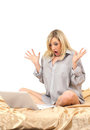 Blonde Woman Working With Laptop On Bed Stock Images - 23826904